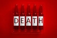 Death of narcotics or drugs addiction concept image. Five ampules with overlay letters of inscription D E A T H. Legal or illegal royalty free stock photos