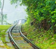 Death Railway along the mountain. This railway is called Death Railway or  Burma–Siam Railway or Thailand–Burma Railway was built during World War II in Stock Images