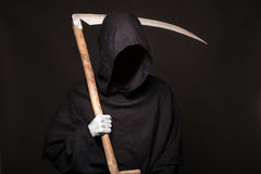 Death reaper over black background. Halloween. Studio portrait on black background Royalty Free Stock Image