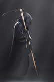 Death with scythe fliesin the fog Royalty Free Stock Photo