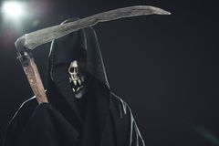 Death with scythe. Standing in the dark Stock Image