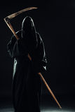 Death with scythe. Standing in the dark Royalty Free Stock Photo