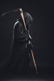 Death with scythe. Standing in the dark Royalty Free Stock Photography