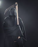 Death with scythe standing in fog Royalty Free Stock Image