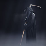 Death with scythe standing in fog Stock Photography
