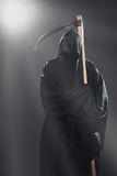 Death with scythe standing in the fog Stock Images