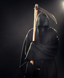 Death with scythe standing in fog at night. Death with scythe standing in the fog at night Royalty Free Stock Photography