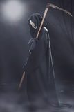 Death with scythe standing at night Royalty Free Stock Photography