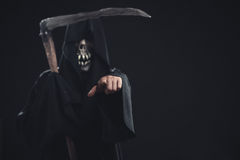 Death with scythe standing at night. Death with scythe standing  at night and points to you Royalty Free Stock Photography