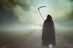 Death with scythe in a surreal landscape. Death with scythe waiting on in a surreal landscape. Halloween and horror Royalty Free Stock Photography