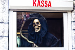 Death with scythe waiting for you on a payday Stock Photos