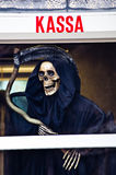 Death with scythe waiting for you on a payday Stock Image
