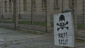 Death Sign on Nazi Extermination Camp. Skull and bones black painted sign on wood plank, o a former Nazi extermination camp stock video