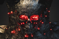 Death, silver armor skull with red eyes and led lights, helmet m Stock Photography