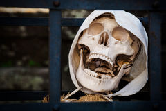 Death. Skeleton prisoner dead. A prisoner is behind bars, his remains only a skeleton with a hood Stock Photos