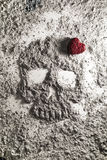 Death skull with red love heart made of ash Royalty Free Stock Images