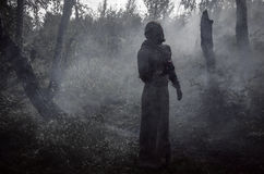 Death in smoke. In the forest Royalty Free Stock Photo