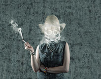 Death smoke. Girl smoking cigarette and a skull in smoke rises up in place of head , suggesting death Stock Photography