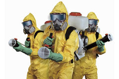 Death to parasites!. The persons in a yellow protective overalls with sprayers in hands Stock Images
