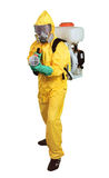 Death to parasites!. The person in a yellow protective overalls with sprayers in hands royalty free stock image