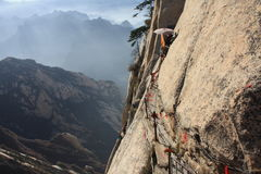 Death Trail at Mt. Hua Peaks. Mount Hua, or Hua Shan (simplified Chinese: 华山),  is a mountain located near the city of Huayin in Shaanxi province, about 120 Royalty Free Stock Image