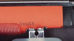 Death - Typed on a old vintage typewriter. Printed on red paper. The red paper is inserted into the typewriter.  stock video footage