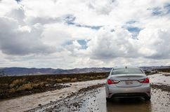 DEATH VALLEY, CALIFORNIA: A flash flood destroys the road through Death Valley National Park, making travel. AUGUST Monsoon Season - DEATH VALLEY, CALIFORNIA: A royalty free stock photo