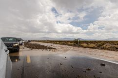 A flash flood destroys the road through Death Valley National Park, making travel. DEATH VALLEY, CALIFORNIA: A flash flood destroys the road through Death Valley stock photography