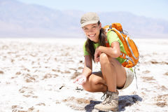 Death Valley. Hiker woman in , California, USA showing dried out salt in Badwater Basin Royalty Free Stock Photo