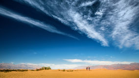 Death Valley. Hikers in the sandy desert of the Death Valley National Park, USA Stock Photo