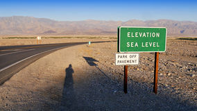 Death Valley Landscape. Death Valley, California - Empty infinite Road in the Desert Stock Image