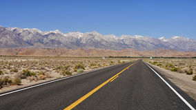 Death Valley Landscape. Death Valley, California - Empty infinite Road in the Desert Royalty Free Stock Photo