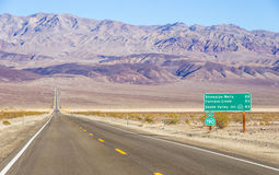 Death Valley landscape,California. Road sign in the Death Valley,California Royalty Free Stock Image