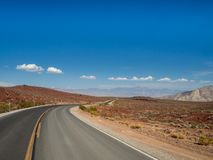 Death Valley, Mojave Desert lone empty road, California, USA: The hottest place on the planet Earth. Death Valley, Mojave Desert road, California, USA: The royalty free stock image
