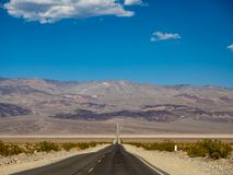 Death Valley, Mojave Desert lone empty road, California, USA: The hottest place on the planet Earth. Death Valley, Mojave Desert road, California, USA: The stock image