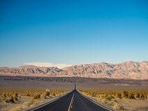 Death Valley, Mojave Desert lone empty road, California, USA: The hottest place on the planet Earth, black and white art photo. Death Valley, Mojave Desert road royalty free stock photos