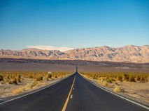 Death Valley, Mojave Desert lone empty road, California, USA: The hottest place on the planet Earth, black and white art photo. Death Valley, Mojave Desert road stock photos
