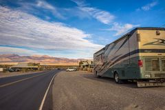Luxury RV parked at the Stovepipe Wells way-station in Death Valley royalty free stock photo