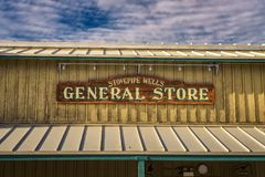 Old fashioned sign for the Stovepipe Wells General Store royalty free stock photography