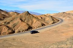 One-way Artists Drive road in the Death Valley National Park in. Death Valley National Park, California, USA - November 23, 2017. One-way Artists Drive road in stock image
