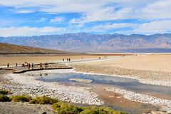 Badwater Basin, at elevation of 85.5 meters below sea level, in. Death Valley National Park, California, USA - November 23, 2017. View of Badwater Basin, at Stock Photography