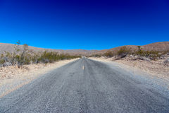 Death Valley National Park: Endless Road. With blue skies Royalty Free Stock Photos