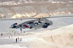 Death Valley National Park - Parking at Zabriskie point. August 2013 - California (USA) - Tourists' parking close to the spectacular view of Zabriskie Point Royalty Free Stock Photo