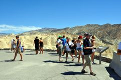 Death Valley National Park - Tourists at Zabriskie point. August 2013 - California (USA) - Tourists enjoying the spectacular view of Zabriskie Point during a Royalty Free Stock Photos