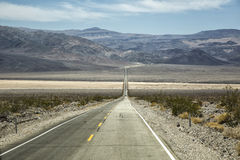 Death Valley, Nevada , road and hills Stock Images
