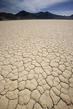 Death Valley Race Track – Playa. The playa at the Death Valley Race Track. The cracks in dry playa make a great pattern that stretches into the distance stock images