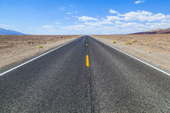 Death Valley road straight across Stock Photo