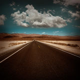 Death Valley straight road in desert National Park Royalty Free Stock Photo