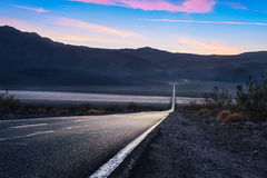 Death Valley & Sunset. Road 190 crossing the death valley national park Royalty Free Stock Images