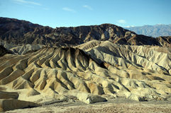 Death Valley tones. Death Valley hills show colorful formation against blue sky royalty free stock image
